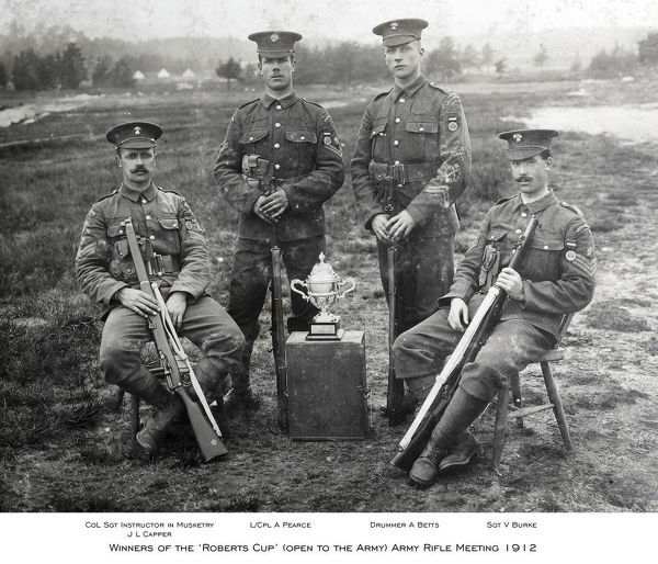 1912, col sgt instructor in musketry j l capper, drummer a betts, l/cpl a pearce, sgt v burke, winners of the & x2018 roberts cup& x2019 (open to the army) army rifle meeting, Album 29, Grenadiers1172